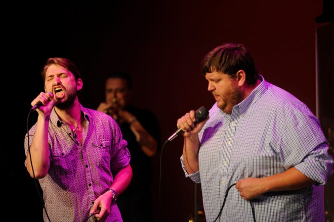 Zach Swenson (left) and Ryan Abel sing during an Ed Turner and Number 9 Rock & Soul Revue show at the Imperial Theatre. Concert footage from the group's 2013 Get Back to The Beatles show will be presented online Jan. 30.