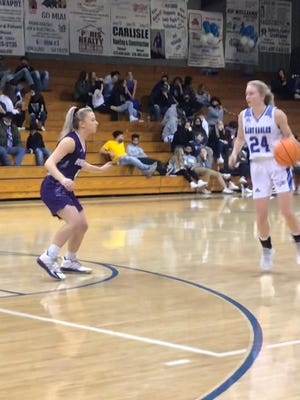 Booneville's Layla Byrum guards Paris' Jadyn Hart (24) during the Jan. 15 game at Paris. Byrum would later make a critical steal and layup to help the LadyCats gain a 50-45 win.