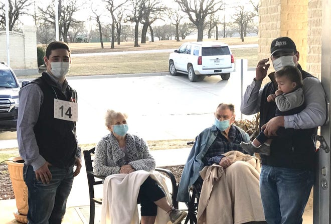 """Sanchez brothers Ethan (left) and Corey) stand near Garner """"Dooder"""" and Sammie McClatchy outside the Senior Care of Brownwood nursing home."""