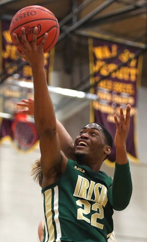 Akron St. Vincent-St. Mary guard Malaki Branham makes a layup in a Jan. 13 game against Walsh Jesuit.