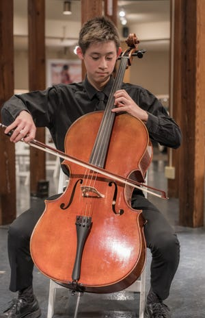 Andrew Juan, the principal cello of the Cape Symphony Youth Orchestra, has been studying at the symphony's conservatory for years. He's among the musicians continuing on virtually with the youth orchestra, which is accepting new musicians by audition.