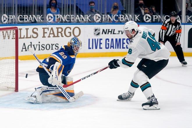 San Jose Sharks' Tomas Hertl, right, scores the game-winning goal past St. Louis Blues goaltender Jordan Binnington during a shootout Wednesday at Enterprise Center in St. Louis.