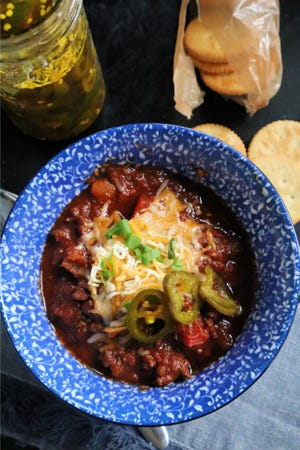 A steaming bowl of beef-and-sausage chili takes the chill off on a cold winter day.
