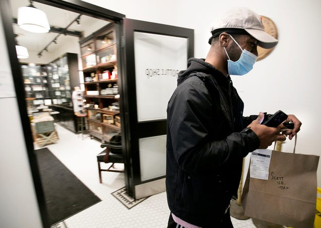 Uber eats driver Antoine Allen picks up a delivery at Service Bar. Columbus City Council recently capped third party delivery fees charged to restaurants by apps like Uber. The fees are in addition to tips paid to drivers.