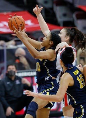 Michigan Wolverines forward Naz Hillmon grabs a rebound against Ohio State Buckeyes forward Rebeka Mikulasikova (23) during the fourth quarter at Value City Arena in Columbus on Thursday, Jan. 21, 2021. Hillmon finished the game with 50 points.