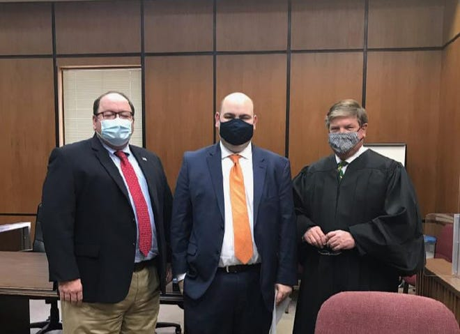 District Attorney Brent Cooper, left, stands with incoming Assistant District Attorney Clay Barnes, center, and Judge J. Russell Parkes, left, inside the Lawrence County Courthouse in Columbia, Tenn.  on Tuesday, Jan. 19, 2021.