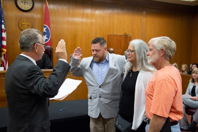 Outgoing Maury County Mayor Charlie Norman swears in Commissioner Brian Vick  during the administration of oaths for incoming and reelected officials inside the Maury County Courthouse on Friday Aug. 31, 2018.