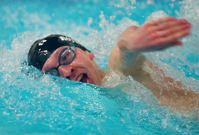 Oak Grove's Landon Roten, shown here winning the 100-yard freestyle in last year's CCC championships, won the 100 breast and anchored the winning 400 free relay on Wednesday. [Donnie Roberts/The Dispatch]