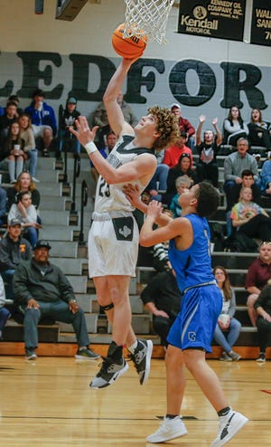 Ledford's Owen Finley gets past Oak Grove's Kahleb Craven for a layup in a game last season. Finley and the Panthers are off to a 4-0 start in 2021. [Michael Coppley for The Dispatch]