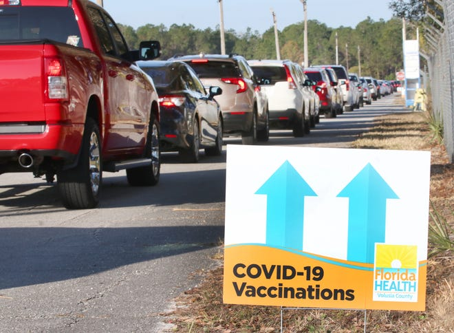 Motorists get in line for COVID-19 vaccine appointments at the Volusia County Fairgrounds on Thursday, Jan. 21, 2021. More vaccinations will be given to seniors with appointments on Friday and Monday.