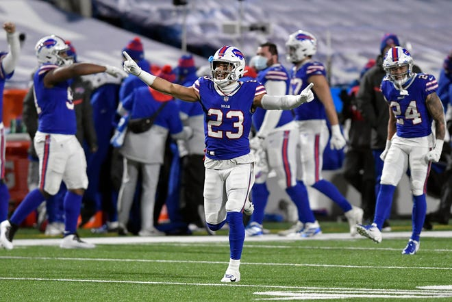 Buffalo Bills' Micah Hyde (23) celebrates with teammates after a divisional playoff win over the Baltimore Ravens last Saturday.