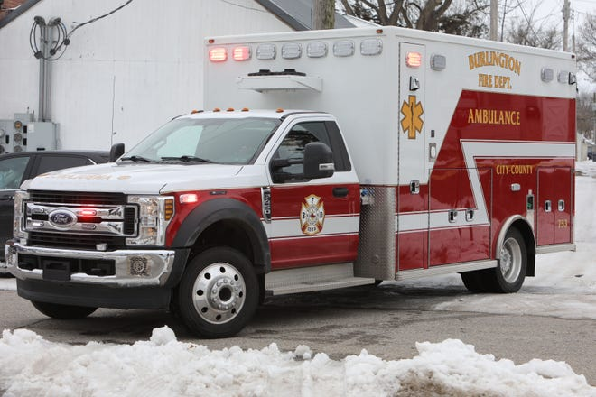 Paramedics with the Burlington Fire Department transport a shooting victim to Great River Medical Center Jan. 8 after responding to an incident along with members of the Burlington Police Department.