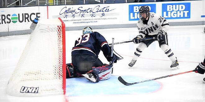 UNH senior forward Patrick Grasso puts a shot on net during last weekend's Hockey East game against Connecticut.