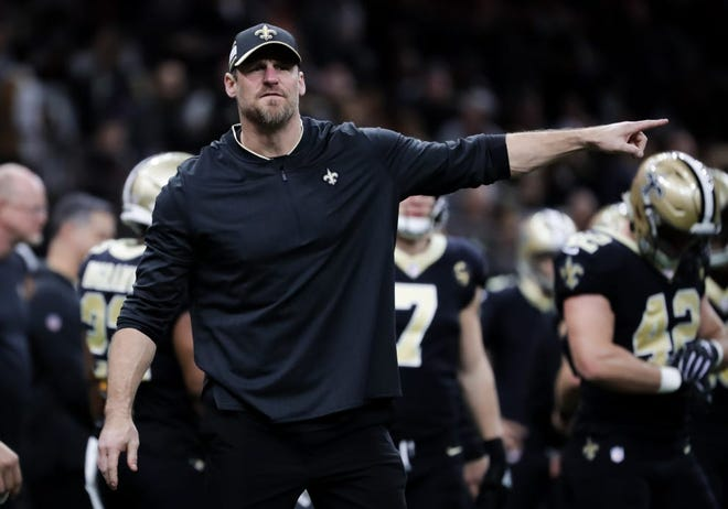 New Orleans Saints assistant head coach and tight end coach Dan Campbell, a Glen Rose High School graduate, signals to players before a playoff against the Philadelphia Eagles at Mercedes-Benz Superdome on Jan. 13, 2019. Campbell inked a six-year deal on Thursday to become the head coach of the Detroit Lions.
