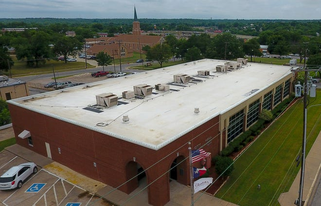 HVAC and air conditioning equipment sits atop Sherman City Hall. The city recently approved an agreement that  calls for equipment at city facilities to be audited for efficiency and cost savings upgrades.