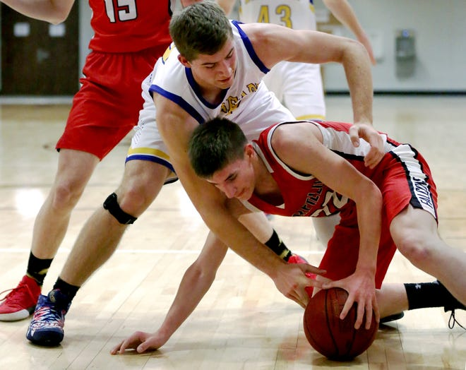 Berean Academy's Austin Thiessen (51) and Fairfield's Ethan Waters (22) reach for the loose ball during their game at the Burrton Invitational Tournament on Wednesday. Berean Academy defeated Fairfield 65-32.