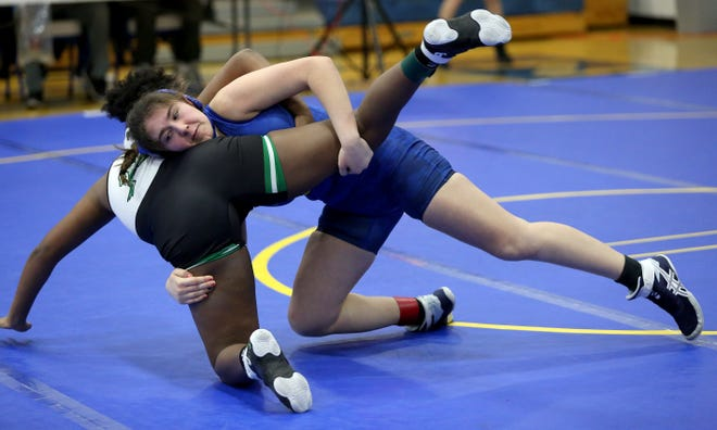Nickerson's Lauren Kinsey wrestles Pratt's Keimarla Thompson in the 155 pound weight class during the Nickerson Invitational Wrestling Tournament Tuesday, Jan. 19, 2021. Thompson won over Kinsey by fall 5:43.  Kinsey placed third in her weight class at the meet.