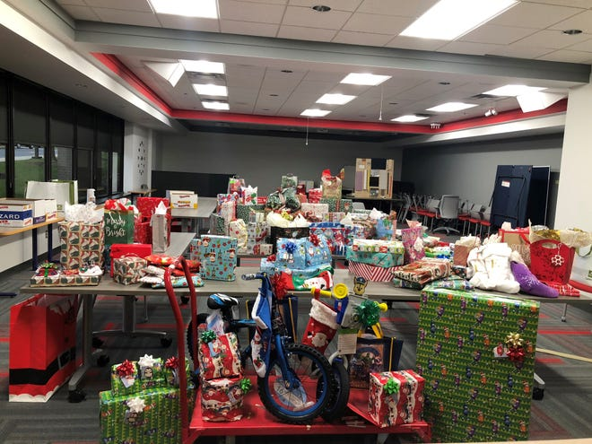In the final weeks of 2020, employees at Mactac's Stow location provided eight area families in need with clothes, toys, grocery and gas cards, diapers and more.