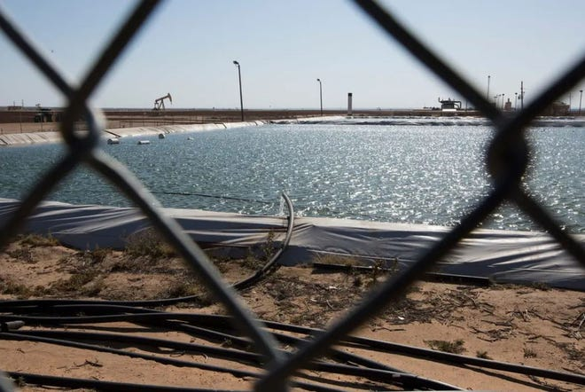 A fracking water retention pond near Big Spring. Wells in the Permian Basin generate six times more water than oil, and companies must dispose of the water through injection wells or other means.
