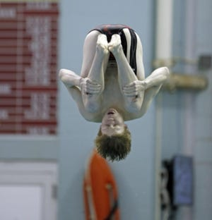 Coronado's Rhett Hensley dives into the pool during the Region I-5A diving championships on Jan. 31, 2020 at the Pete Ragus Aquatic Center