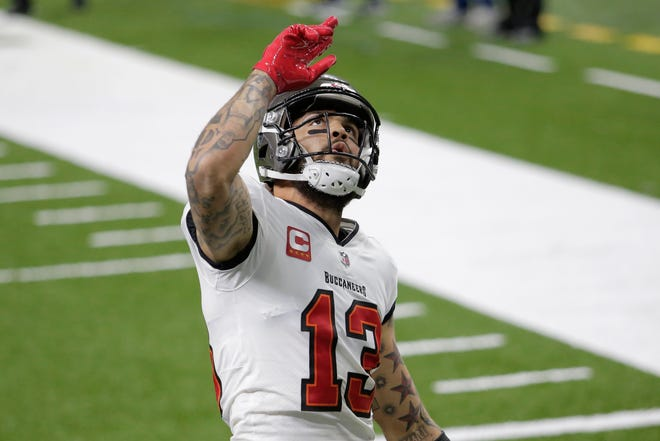 Tampa Bay Buccaneers wide receiver Mike Evans celebrates his touchdown against the New Orleans Saints during the first half on Jan. 17. If Tampa Bay Times columnist John Romano is right, Evans and the Bucs will do even more celebrating this Sunday.