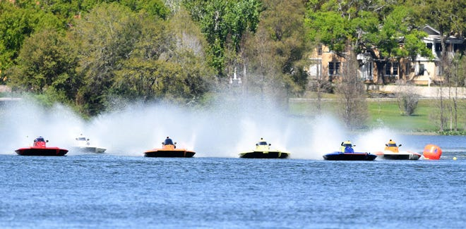 Boats take off at the start of heat 1 of the 2.5-liter stock hydroplanes during the 81st Orange Cup Regatta on Lake Hollingsworth in Lakeland in 2019. The event, which is typically in March, has been postponed this year until October because of COVID-19.