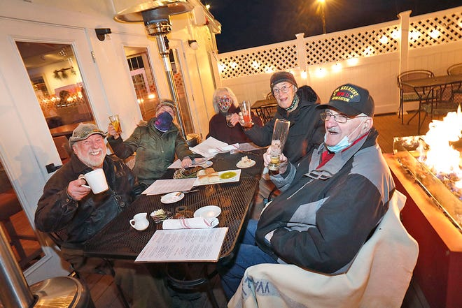 """Mal"" raises a glass with his family at Sorelle in Abington on Thursday Jan. 21, 2021. The family of Malcolm ""Mal"" MacLeod take him out each Wednesday to restaurants where they can eat outside due to COVID-19."
