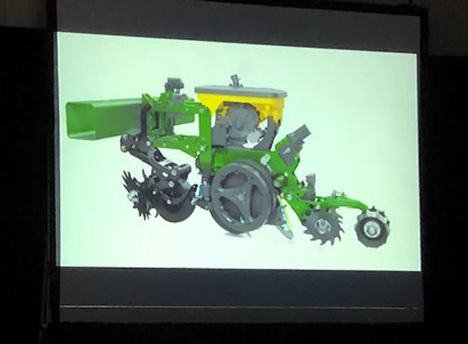The new Precision Planting concept called Reveal is shown to farmers attending the Precision Planting Winter Conference.