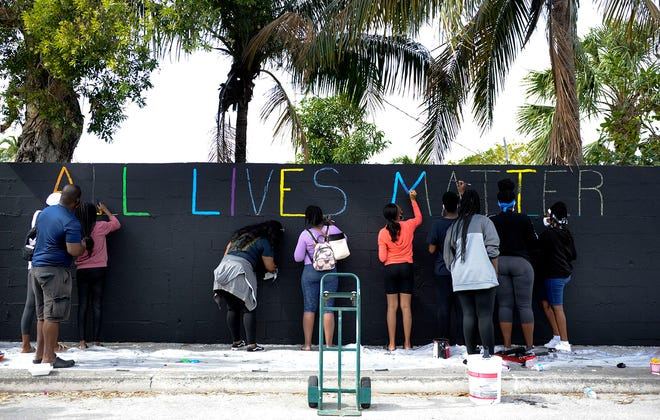 "A mural with the words ""All Lives Matter"" has been removed from the Wall of Unity on Wingfield Street in Lake Worth Beach after members of the community expressed outrage."