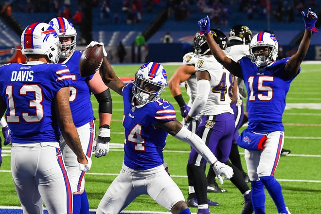 Buffalo Bills wide receiver Stefon Diggs (14) celebrates his touchdown with teammates. [RICH BARNES/USA TODAY Sports]