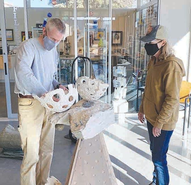 Kansas artist Ron Michael sets up part of his display at the Vernon Filley Art Museum in preparation for the coming Ninnescah Art Exhibition which opens Saturday, January 30, 2021 in Pratt.