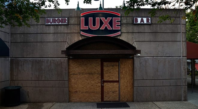 Providence's Luxe Burger Bar restaurant, closed and boarded up last September. Rhode Island's hospitality industry has taken a severe hit during the pandemic.