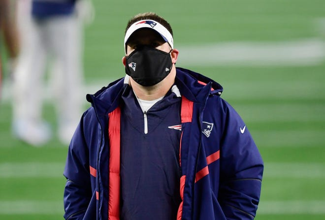 Offensive coordinator Josh McDaniels of the New England Patriots looks on during warmups before the game against the Buffalo Bills at Gillette Stadium on Dec. 28, 2020 in Foxborough, Massachusetts.