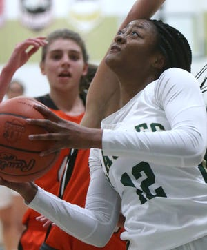 Aniyah Hall (12) of GlenOak goes to the basket during a game against Hoover last month.