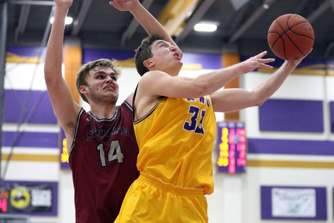 Kansas Wesleyan's Trey Duffey (33) goes up for a shot against Sterling's Grant Olson (14) during Wednesday's game at Mabee Arena.