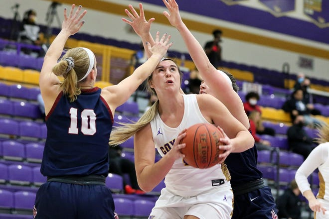 Kansas Wesleyan's Kelcey Hinz (1) avoids being double teamed by Sterling's Sydney Bangert (10) and Bethany Stucky (30) during Wednesday's game at Mabee Arena.