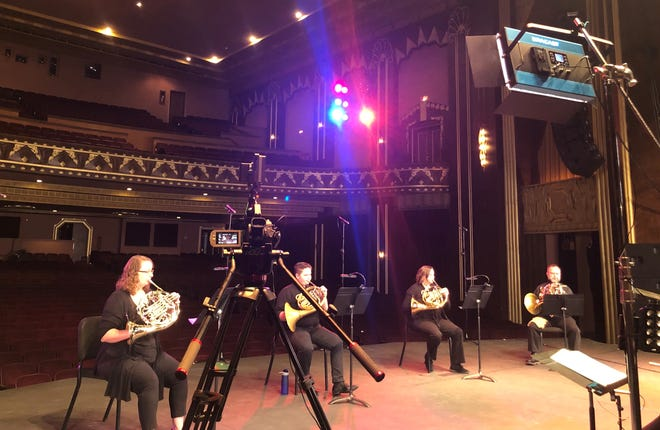 """The Salina Symphony Horn Quartet prepares to film a segment for the next """"Listen Together"""" Virtual Chamber Concert Series, which also features a cello/piano duo. The concert will premiere at 4 p.m. Sunday on the Salina Symphony's Facebook page."""