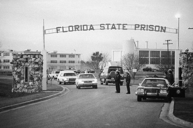 A white hearse leaves Florida State Prison in Starke containing the body of Theodore Bundy who was electrocuted in Florida's electric chair Jan. 24, 1989.