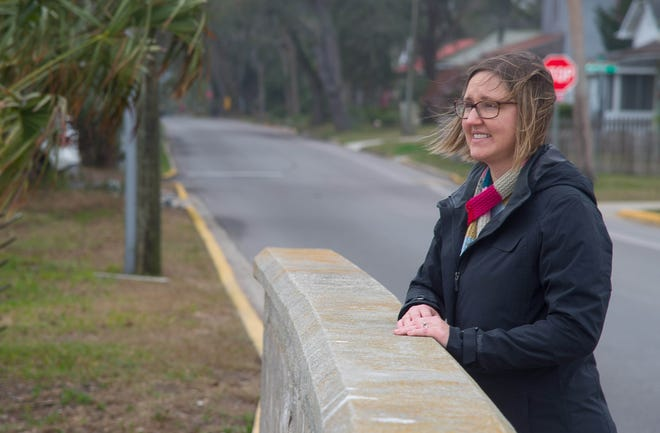 Jessica Beach stands on a bridge on South Street where Lake Maria Sanchez flows into the Matanzas River in February 2018. The city of St. Augustine chose Beach as its chief resilience officer, a role that includes reducing flooding in the city ― a project at Lake Maria Sanchez is part of those efforts.