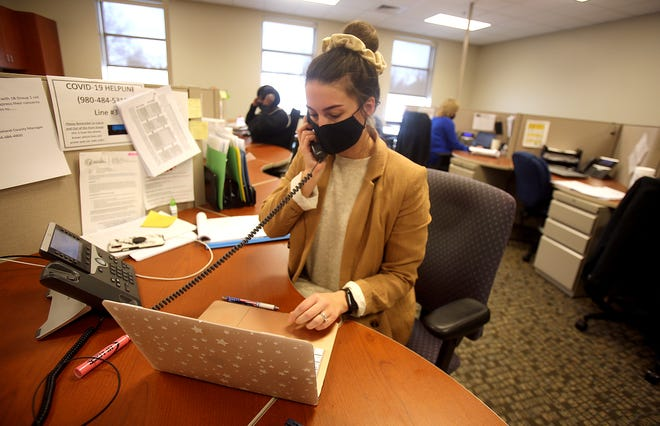 Jana Bradley takes calls while working at the COVID-19 Helpline at the Cleveland County Public Health Center on Thursday.