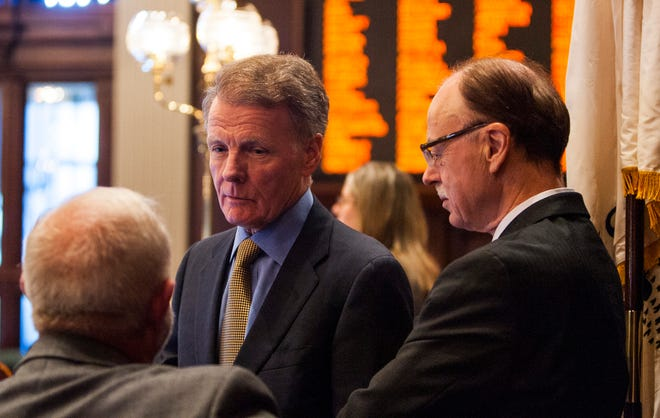 In this Aug. 17, 2012 image, then-Speaker of the House Michael Madigan, D-Chicago, center, talks with Steve Brown, spokesman for the speaker, left, and chief of staff Tim Mapes. [Justin L. Fowler/The State Journal-Register]