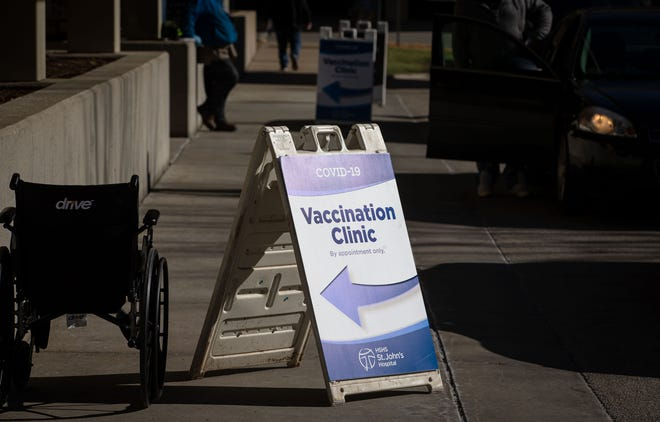 HSHS St. John's Hospital has started distributing the Pfizer-BioNTech COIVD-19 vaccine to their patients that are 65 and older in the Dove Conference Center in the Prairie Heart Institute, Thursday, January 21, 2021, in Springfield, Ill. [Justin L. Fowler/The State Journal-Register]