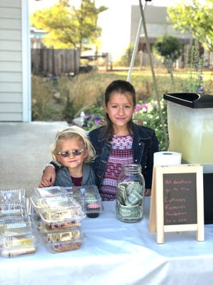 Sisters Emma Suetta, 7, and Lilly Suetta, then 9, of Greenview sell lemonade and baked goods at their fourth annual bake sale to raise money for the Cystinosis Research Foundation. They started doing the fundraiser in 2017. Emma was diagnosed with cystinosis, a rare disease affecting about 500 to 600 Americans,  when she was a baby.