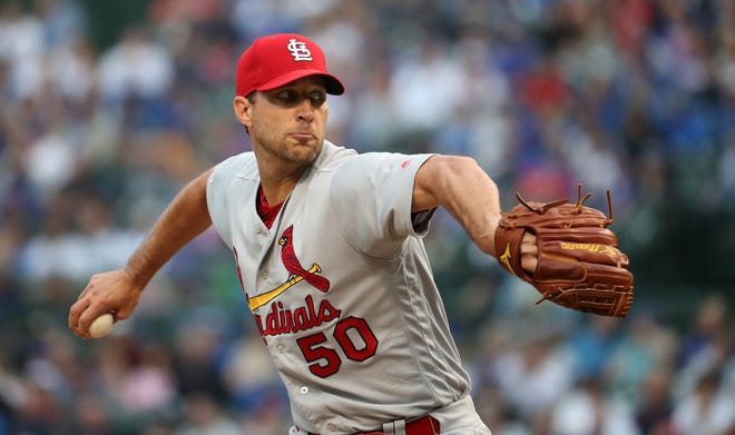 St. Louis Cardinals starting pitcher Adam Wainwright delivers to the Chicago Cubs in the second inning on Sunday, June 9, 2019 at Wrigley Field in Chicago.