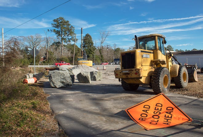 Heavy equipment sits at the end of a torn up Oakwood Drive in Havelock. City Manager Frank Bottorff said erosion was the reason for the repairs. He said this portion is not related to the two sewer repairs that began last year and will continue. One sewer project is scheduled to be completed in February and another will start in December.
