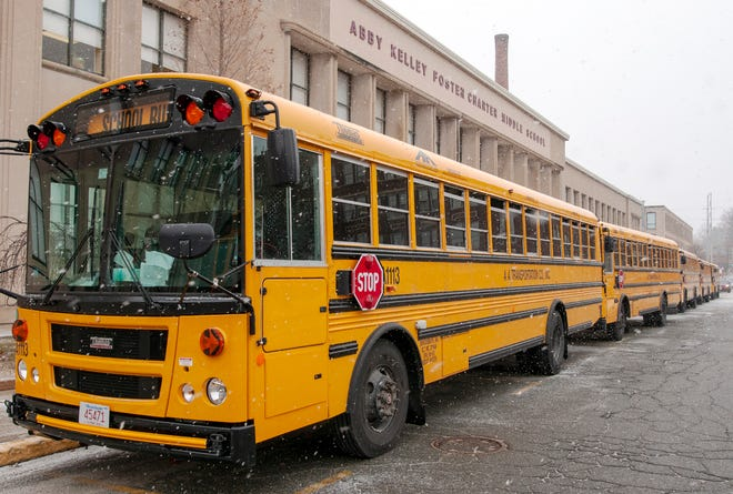 School buses arrive to pick up students Thursday at the Abby Kelley Foster Charter Public School on New Bond Street in Worcester.