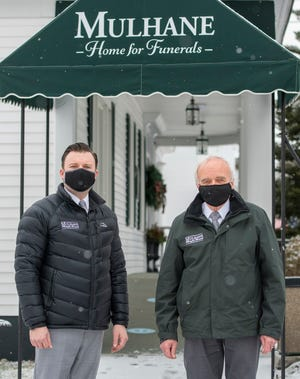 MILLBURY - Matthew Mulhane, left, and his father Stuart Mulhane own Mulhane Home For Funerals in Millbury Thursday, January 21, 2021.