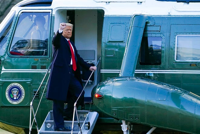 President Donald Trump gestures as he boards Marine One on the South Lawn of the White House, Wednesday, Jan. 20, 2021, in Washington. Trump was en route to his Mar-a-Lago Florida Resort. (AP Photo/Alex Brandon)