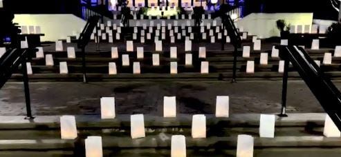 Luminaries representing Alamance County residents who died during the COVID-19 pandemic line the Municipal Building steps in Burlington Tuesday, Jan. 19. [SUBMITTED PHOTO]