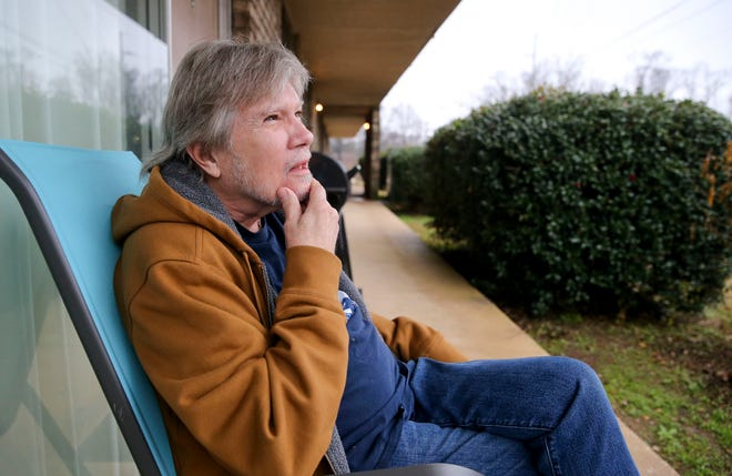 Bill Connell sits outside his apartment in Tuscaloosa Thursday Jan. 21, 2020. Connell is writing a memoir about his years in the music business. He played with Gregg and Duane Allman in one of their earlier bands called the Allman Joys. [Staff Photo/Gary Cosby Jr.]